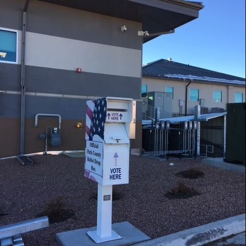 Fairplay voting box with American flag design outside building