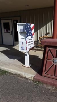 Bailey voting box with American flag design outside building