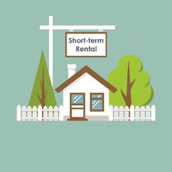 House with tree's, fence and Short Term Rental sign